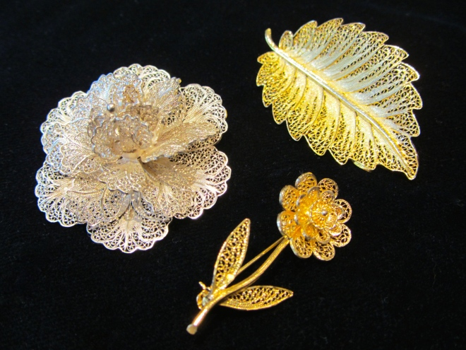 Floral themes are common in filigree jewelry, as are hearts and beads.